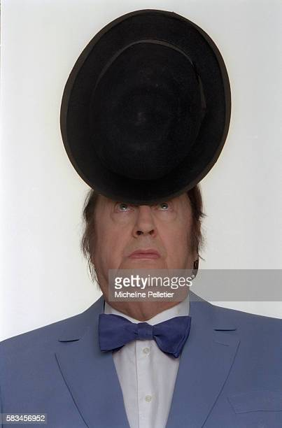 Comedian Raymond Devos Balancing Hat on Nose