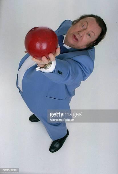 Comedian Raymond Devos Holding Ball