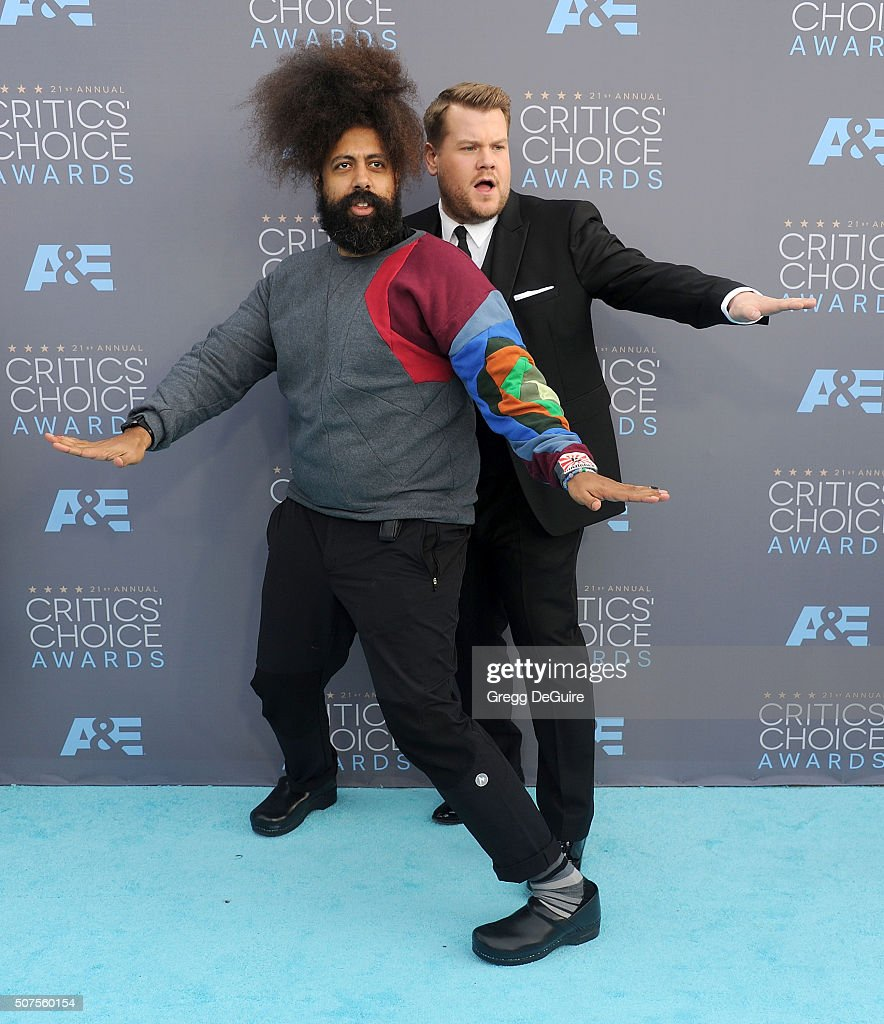 Comedian Reggie Watts and TV personality James Corden arrive at the 21st Annual Critics' Choice Awards at Barker Hangar on January 17, 2016 in Santa Monica, California.