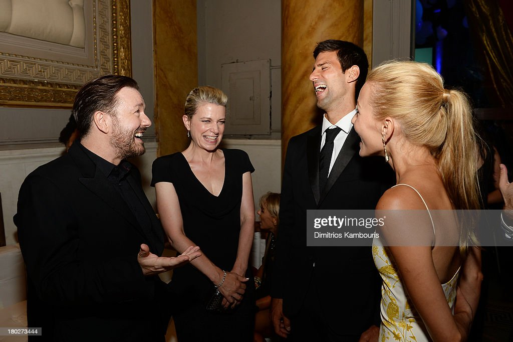 Comedian Ricky Gervais, author Jane Fallon, Founding Chairman of the Novak Djokovic Foundation Novak Djokovic, and Executive Director of the Novak Djokovic Foundation Jelena Ristic attend the Novak Djokovic Foundation New York dinner at Capitale on September 10, 2013 in New York City.