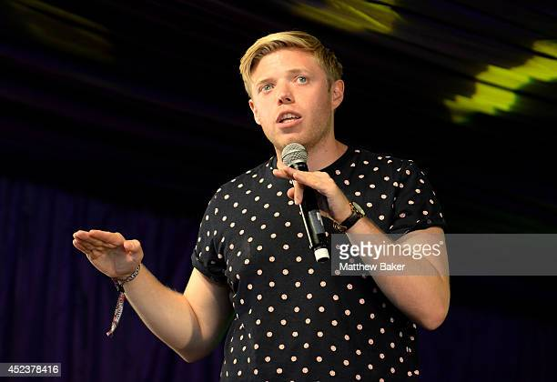 Comedian Rob Beckett performs on stage in the Comedy tent at the Latitude Festival at Henham Park Estate on July 19 2014 in Southwold England