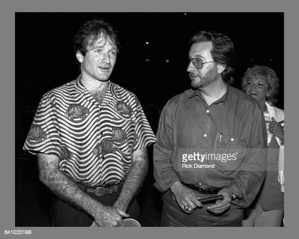 Comedian Robin Williams chats backstage with concert promoter Peter Conlon at Chastain Park Amphitheater in Atlanta Georgia May 10 1986
