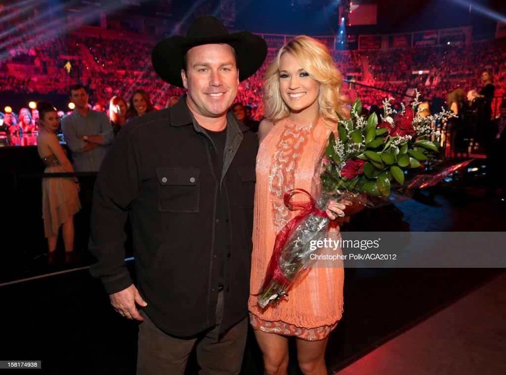 Comedian Rodney Carrington (R) and singer Carrie Underwood attend the 2012 American Country Awards at the Mandalay Bay Events Center on December 10, 2012 in Las Vegas, Nevada.