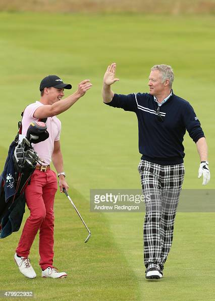Comedian rory bremner highfives his caddie during the proam prior to