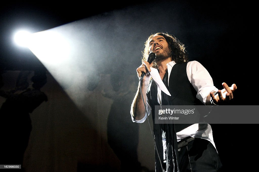 Comedian Russell Brand introduces singer Morrissey at Hollywood High School on March 2, 2013 in Los Angeles, California.