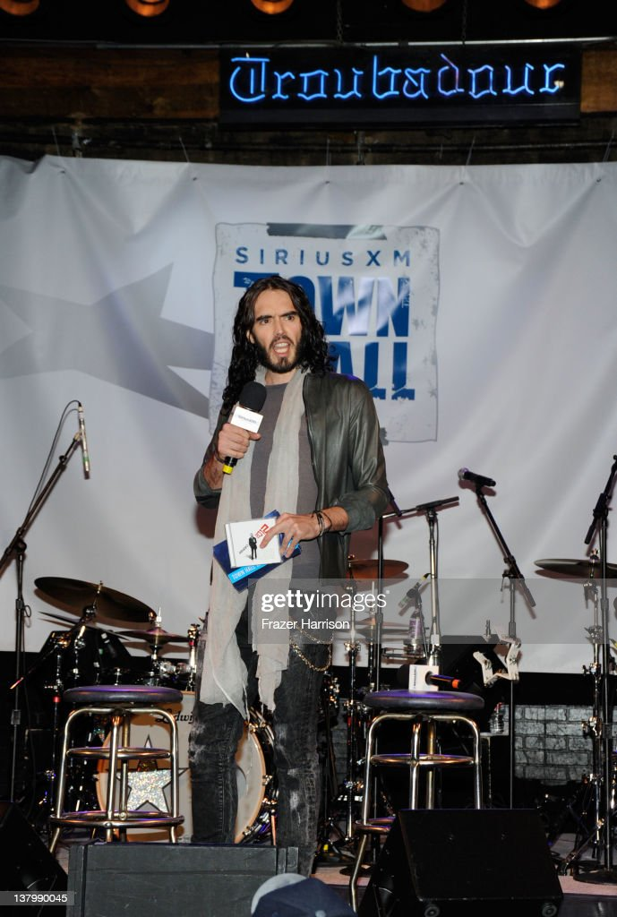 Comedian <a gi-track='captionPersonalityLinkClicked' href=/galleries/search?phrase=Russell+Brand&family=editorial&specificpeople=536593 ng-click='$event.stopPropagation()'>Russell Brand</a> on stage at 'SiriusXM's Town Hall With Ringo Starr' And Host <a gi-track='captionPersonalityLinkClicked' href=/galleries/search?phrase=Russell+Brand&family=editorial&specificpeople=536593 ng-click='$event.stopPropagation()'>Russell Brand</a> and Moderator Don Was Live On SiriusXM's The Spectrum Channel performs at Troubadour on January 30, 2012 in West Hollywood, California.