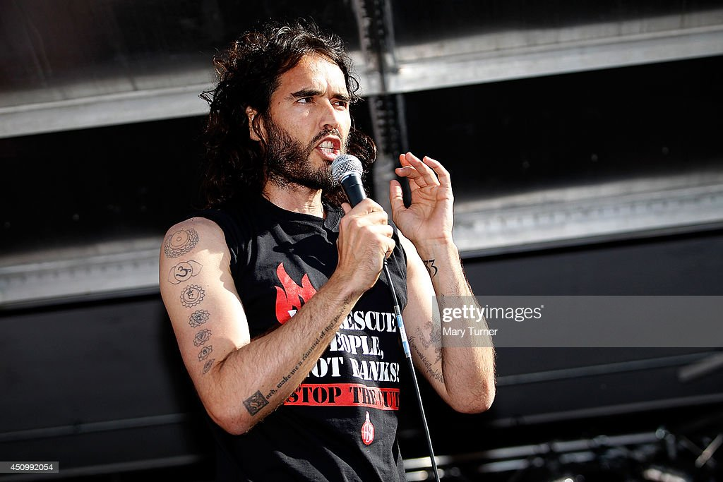 Comedian <a gi-track='captionPersonalityLinkClicked' href=/galleries/search?phrase=Russell+Brand&family=editorial&specificpeople=536593 ng-click='$event.stopPropagation()'>Russell Brand</a> speaks to a crowd of thousand of demonstrators that gathered in Parliament Square, on June 21, 2014 in London, England. The crowd marched from Oxford Circus to Parliament Square to voice their opposition to government austerity cuts.