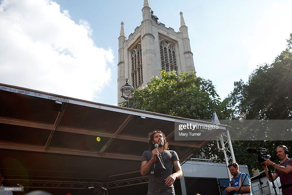 Comedian <a gi-track='captionPersonalityLinkClicked' href=/galleries/search?phrase=Russell+Brand&family=editorial&specificpeople=536593 ng-click='$event.stopPropagation()'>Russell Brand</a> speaks to a crowd of thousands of demonstrators that gathered in Parliament Square, on June 21, 2014 in London, England. The crowd marched from Oxford Circus to Parliament Square to voice their opposition to government austerity cuts.