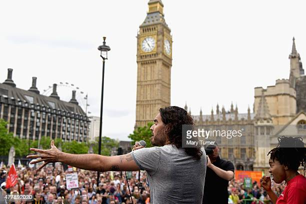 Comedian Russell Brand speaks to thousands of demonstrators gathered in Parliament Square to protest against austerity and spending cuts on June 20...