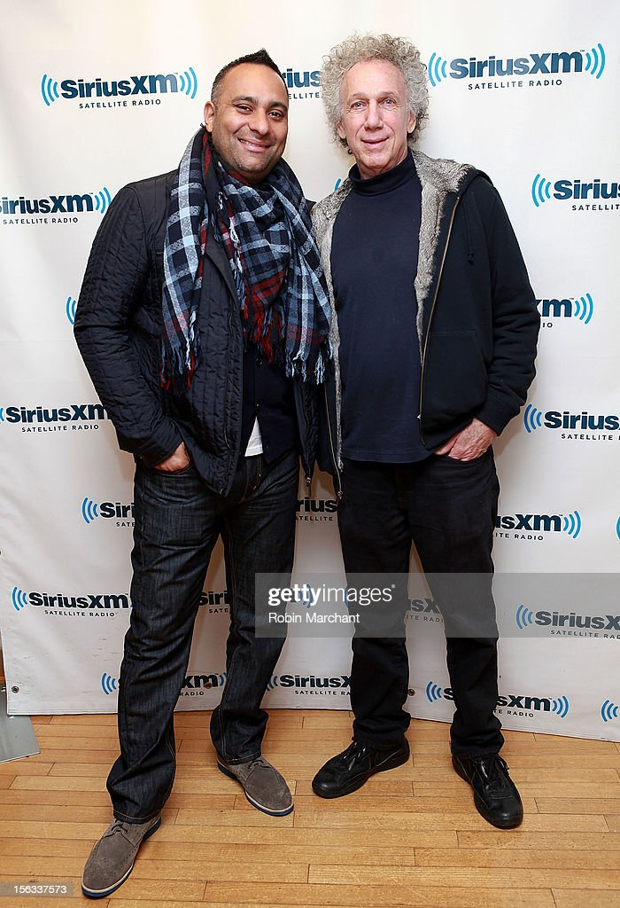 Comedian <a gi-track='captionPersonalityLinkClicked' href=/galleries/search?phrase=Russell+Peters&family=editorial&specificpeople=2090934 ng-click='$event.stopPropagation()'>Russell Peters</a> (L) and Photographer Bob Gruen visits the SiriusXM Studios on November 13, 2012 in New York City.