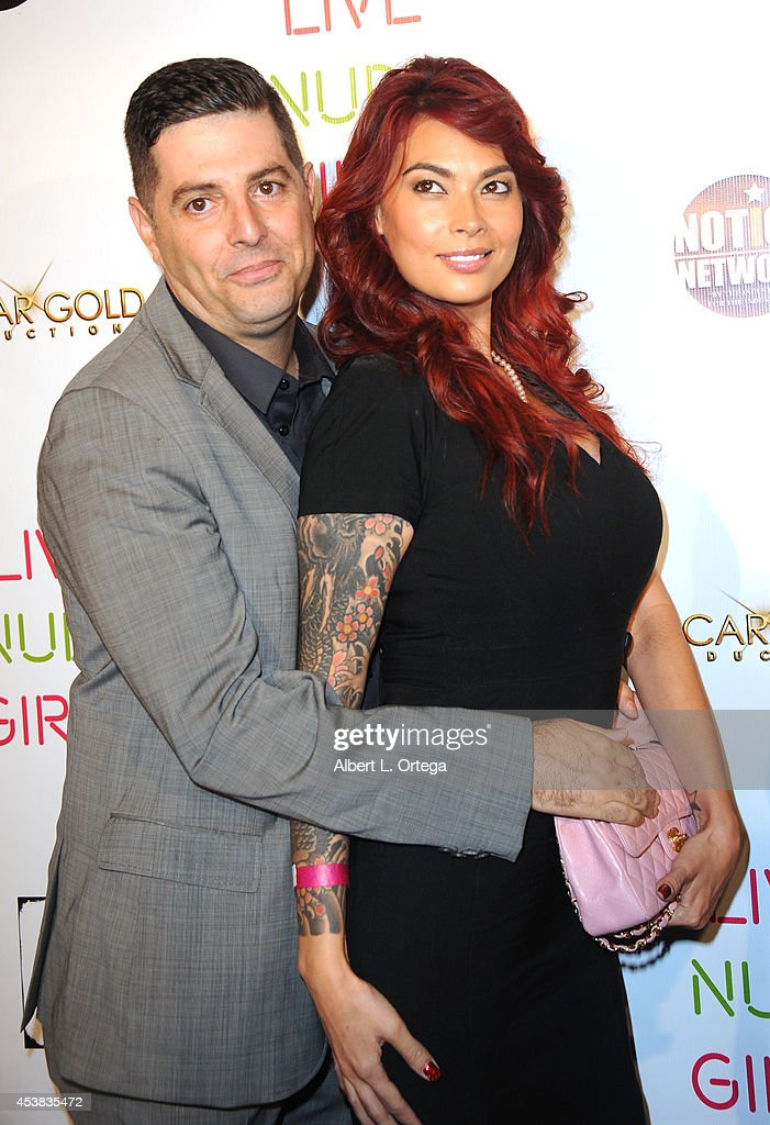 Comedian Sam Tripoli and adult film star <a gi-track='captionPersonalityLinkClicked' href=/galleries/search?phrase=Tera+Patrick&family=editorial&specificpeople=241484 ng-click='$event.stopPropagation()'>Tera Patrick</a> arrive at the premiere of 'Live Nude Girls' held at Avalon on August 12, 2014 in Hollywood, California.