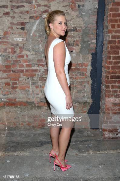 Comedian Schumer poses backstage at the Christian Siriano fashion show during MercedesBenz Fashion Week Spring 2015 at Eyebeam on September 6 2014 in...