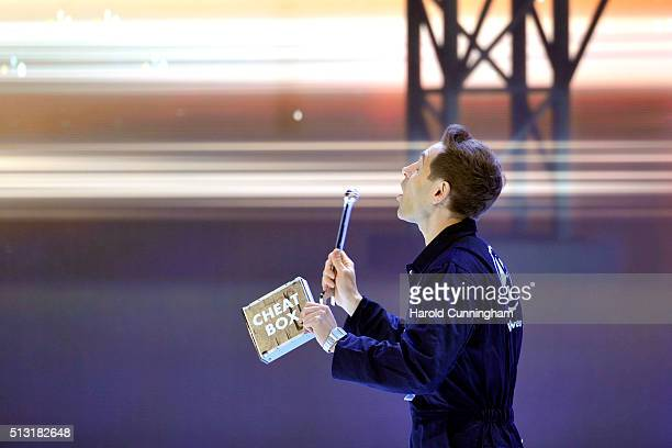 Comedian Simon Brodkin disrupts the Volkswagen press conference during the Geneva Motor Show 2016 on March 1 2016 in Geneva Switzerland
