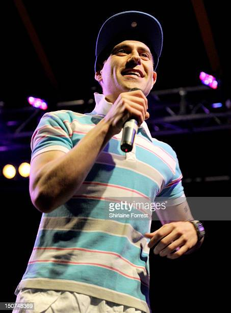 Comedian Simon Brodkin performs as Lee Nelson on day two of Leeds Festival at Bramham Park on August 25 2012 in Leeds England