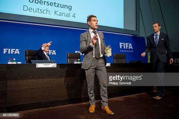 Comedian Simon Brodkin prepares to attack FIFA President Joseph S Blatter with money during a press conference at the Extraordinary FIFA Executive...