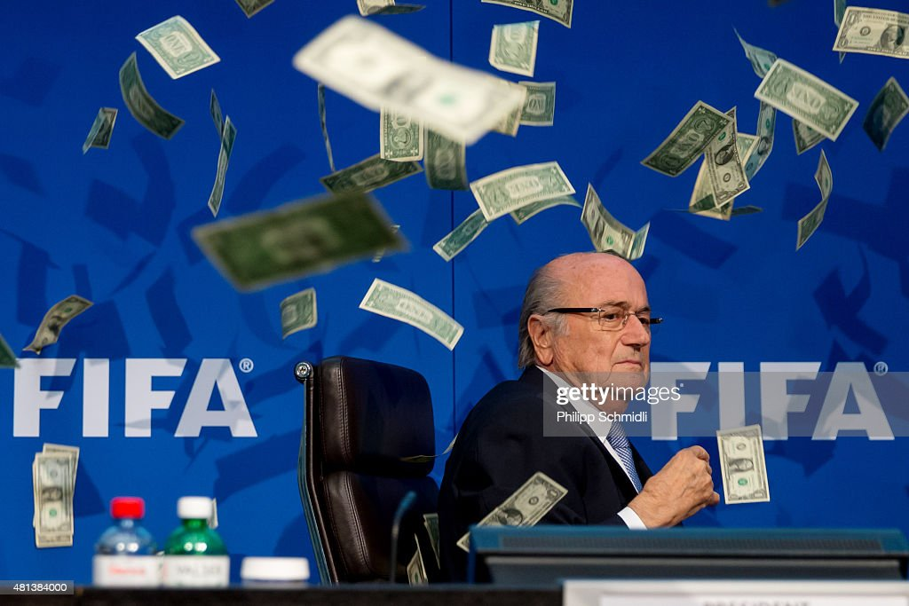 Comedian Simon Brodkin (not pictured) throws cash at FIFA President Joseph S. Blatter during a press conference at the Extraordinary FIFA Executive Committee Meeting at the FIFA headquarters on July 20, 2015 in Zurich, Switzerland.