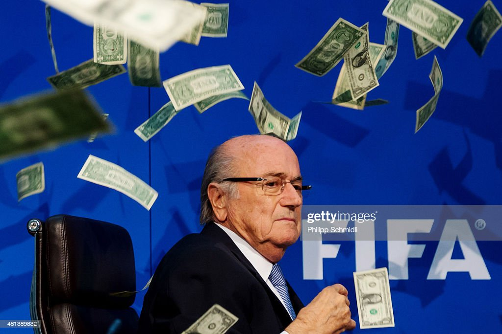 Comedian Simon Brodkin (not pictured) throws dollar bills at FIFA President Joseph S. Blatter during a press conference at the Extraordinary FIFA Executive Committee Meeting at the FIFA headquarters on July 20, 2015 in Zurich, Switzerland.
