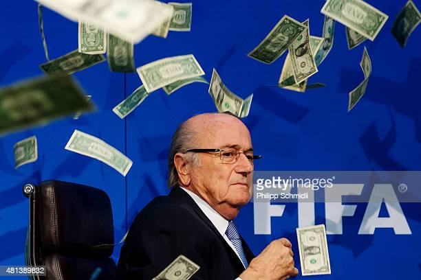 Comedian Simon Brodkin throws dollar bills at FIFA President Joseph S Blatter during a press conference at the Extraordinary FIFA Executive Committee...