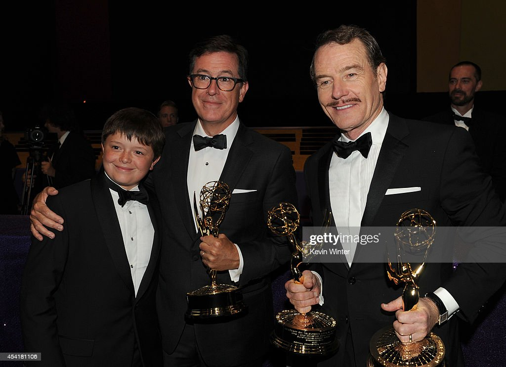 Comedian Stephen Colbert (C) winner of the Outstanding Variety Series for 'The Colbert Report', son, and actor Bryan Cranston, winner of Outstanding Drama Series and Outstanding Lead Actor in a Drama Series for 'Breaking Bad,' attend the 66th Annual Primetime Emmy Awards Governors Ball held at Los Angeles Convention Center on August 25, 2014 in Los Angeles, California.