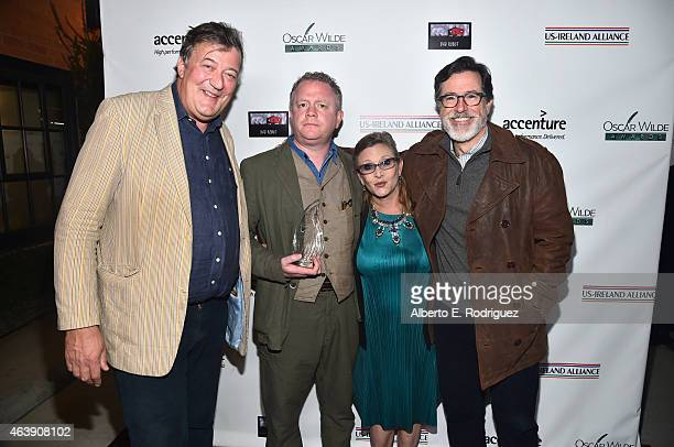 Comedian Stephen Fry and honorees Colin Davidson Carrie Fisher and Stephen Colbert attend the USIreland Aliiance's Oscar Wilde Awards event at JJ...