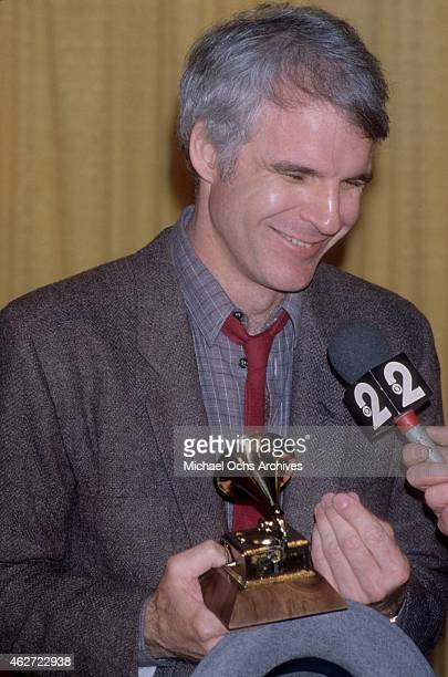 Comedian Steve Martin holds up the Grammy that he won for his album 'A Wild And Crazy Guy' at the Shrine Auditorium on February 15 1979 in Los...