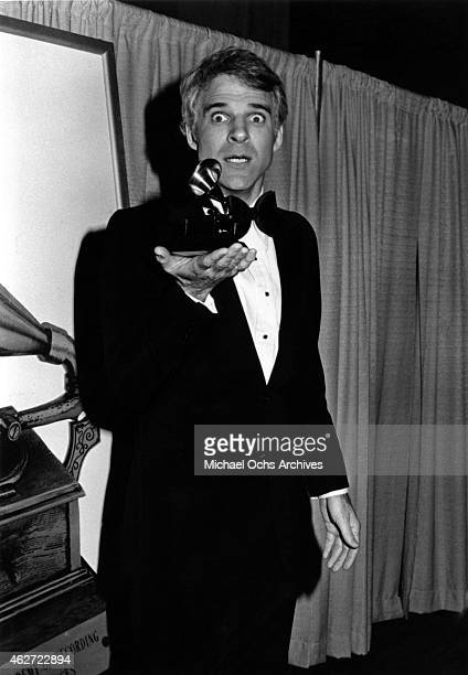 Comedian Steve Martin holds up the Grammy that he won for his album 'Let's Get Small' at the Shrine Auditorium on February 23 1978 in Los Angeles...