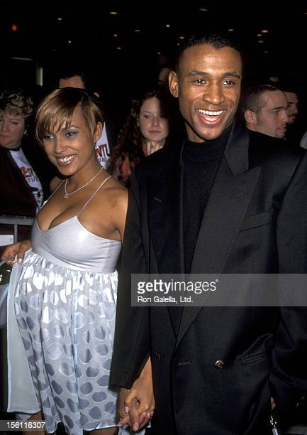 Comedian Tommy Davidson and wife attend the 'Ace Ventura When Nature Calls' Westwood Premiere on November 8 1995 at Mann Village Theatre in Westwood...