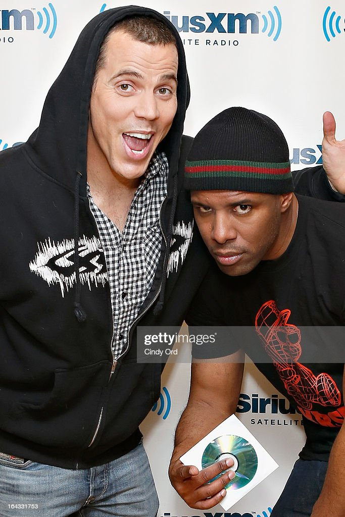 Comedian/ TV personality Steve-O poses with SiriusXM host DJ Whoo Kid at the SiriusXM Studios on March 22, 2013 in New York City.