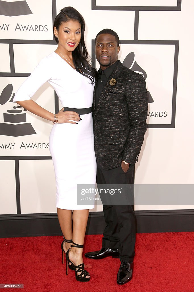 Comedian/actor Kevin Hart (R) and Eniko Parrish attend the 56th GRAMMY Awards at Staples Center on January 26, 2014 in Los Angeles, California.
