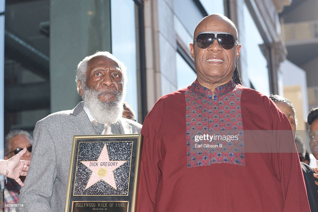 Comedian/Civil Rights Activist <a gi-track='captionPersonalityLinkClicked' href=/galleries/search?phrase=Dick+Gregory+-+Activist&family=editorial&specificpeople=226818 ng-click='$event.stopPropagation()'>Dick Gregory</a> is joined by the legendary recording artist <a gi-track='captionPersonalityLinkClicked' href=/galleries/search?phrase=Stevie+Wonder&family=editorial&specificpeople=171911 ng-click='$event.stopPropagation()'>Stevie Wonder</a> as <a gi-track='captionPersonalityLinkClicked' href=/galleries/search?phrase=Dick+Gregory+-+Activist&family=editorial&specificpeople=226818 ng-click='$event.stopPropagation()'>Dick Gregory</a> receives his star On The Hollywood Walk Of Fame on February 2, 2015 in Hollywood, California.