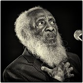 Comedian/civil rights activist Dick Gregory speaks on stage following the opening night performance of 'Turn Me Loose' held at The Westside Theatre...
