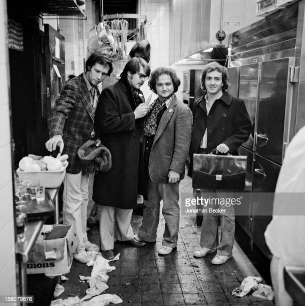 Comedians Chevy Chase Dan Aykroyd John Belushi and Lorne Michaels are photographed for Vanity Fair Magazine in January 1976 in Elaine's Kitchen in...