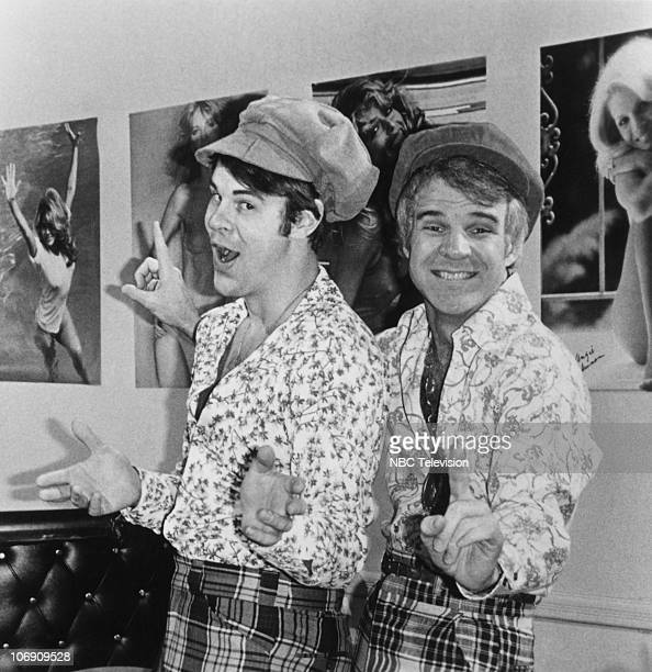 Comedians Dan Aykroyd and Steve Martin posing as the 'two wild and crazy guys' a sketch from the television show 'Saturday Night Live' circa 1978...