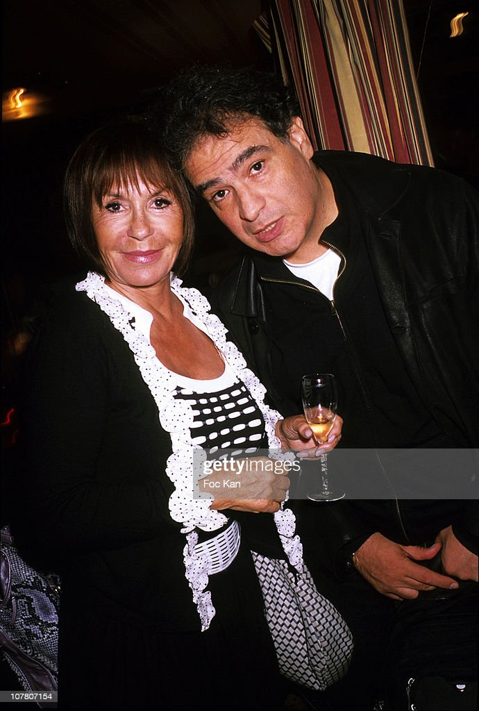 Comedians Daniele Evenou and Raphael Mezrahi attend the Patrick Goavec Birthday Party at the Berkeley Club on September 14, 2009 in Paris, France.