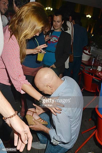 Comedians Dounia Coesens and Evan Handler attend 'La Boumette' Party at L'Opera Restaurant on June 7 2014 in Paris France