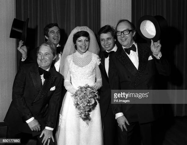 Comedians Eric Morecambe and Ernie Wise with Susan Daughter of singer Frankie Vaughan and her Husband Paul Sassienie following the couples wedding at...