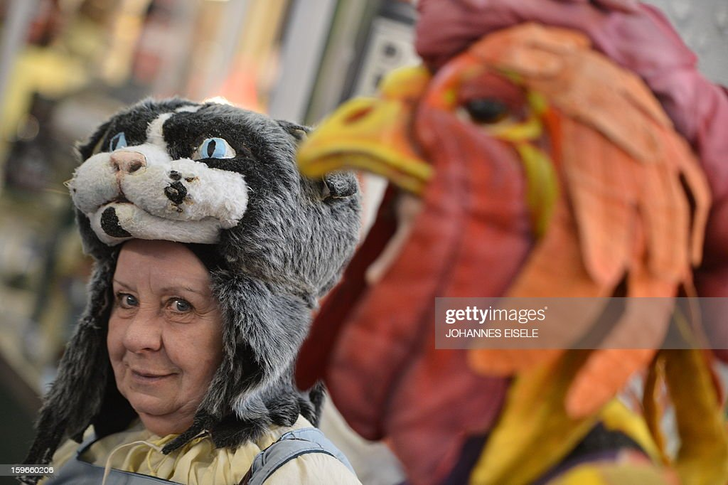 Comedians feature a scene of brothers Grimm's tale Town Musicians of Bremen (Die Bremer Stadtmusikanten) during the opening of the Gruene Woche (Green Week) Agricultural Fair in Berlin on January 18, 2013. This year the official partner country of the fair is The Netherlands. EISELE