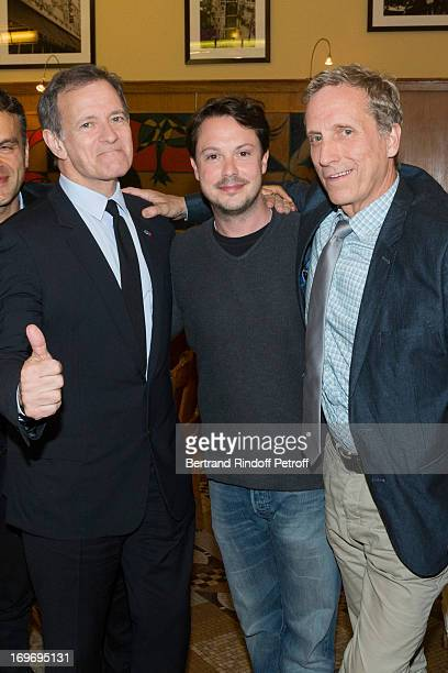 Comedians Francis Huster and Davy Sardou standing with autor Bill C Davis 'L'Affrontement' Theater Play at Rive Gauche Theater on May 30 2013 in...