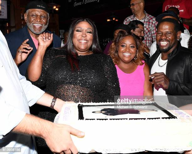 Comedians George Wallace Loni Love Sherri Shepherd and Scruncho pose before Loni Love blows out the candles on her cake at the after party at Loni...