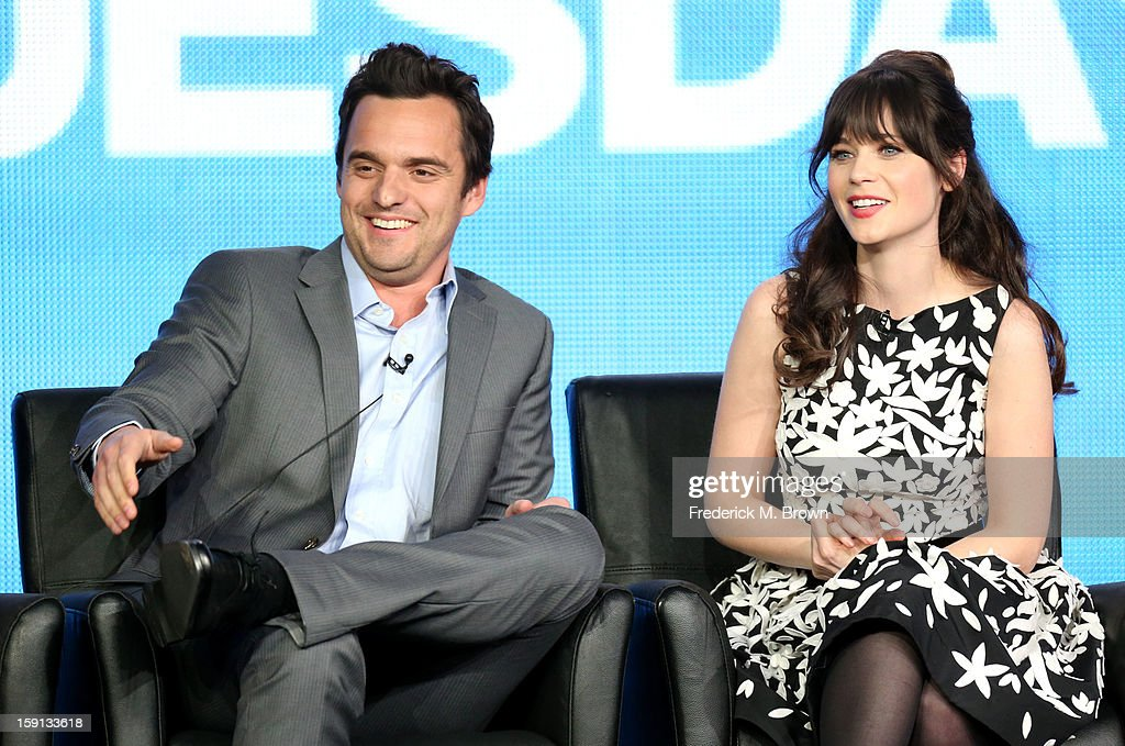 Comedians Jake Johnson and <a gi-track='captionPersonalityLinkClicked' href=/galleries/search?phrase=Zooey+Deschanel&family=editorial&specificpeople=202927 ng-click='$event.stopPropagation()'>Zooey Deschanel</a> of 'New Girl' speak onstage during the FOX portion of the 2013 Winter TCA Tour at Langham Hotel on January 8, 2013 in Pasadena, California.