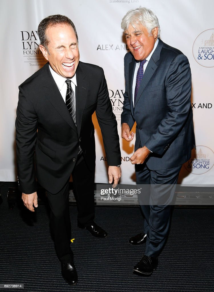 Comedians Jerry Seinfeld (L) and Jay Leno burst into laughter as they arrive to the National Night of Laughter and Song event hosted by David Lynch Foundation at the John F. Kennedy Center for the Performing Arts on June 5, 2017 in Washington, DC.