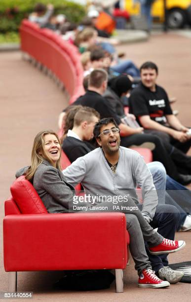 Comedian's Karen Daunbar and Sanjeev Kohli sit on the world's longest sofa in Glasgow's George Square to promote Maggie's cancer charity