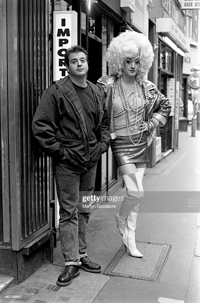 Comedians Mark Thomas and Paul O'Grady (in character as Lily Savage), Soho, London, United Kingdom, 1993.