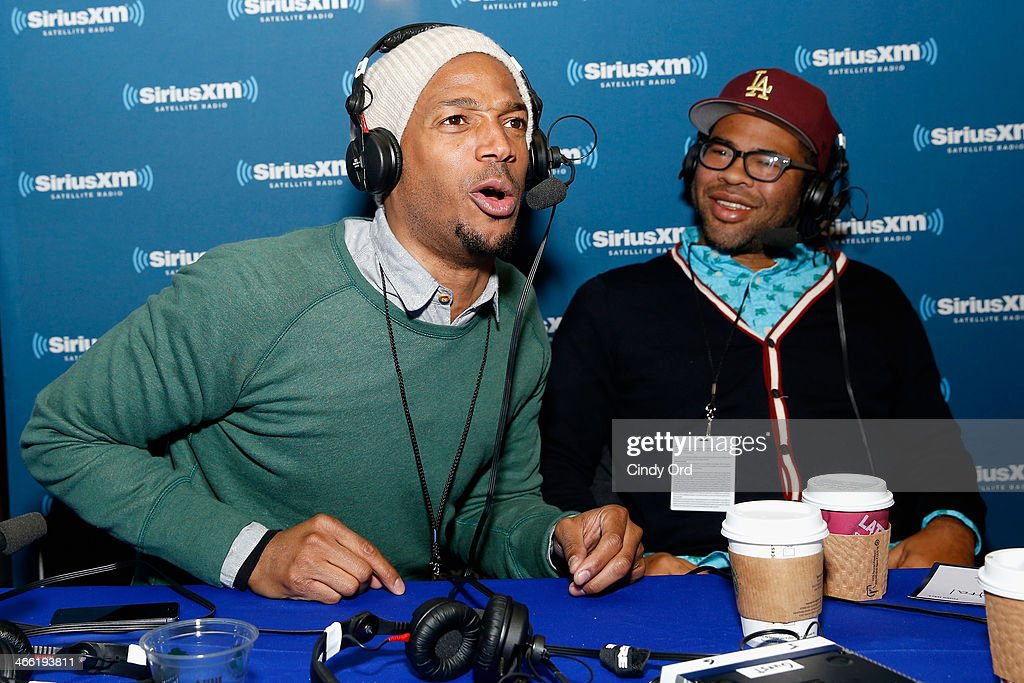 Comedians Marlon Wayans (L) and Jordan Peele attend SiriusXM's Comedy Central Radio at Super Bowl XLVIII Radio Row on January 31, 2014 in New York City.