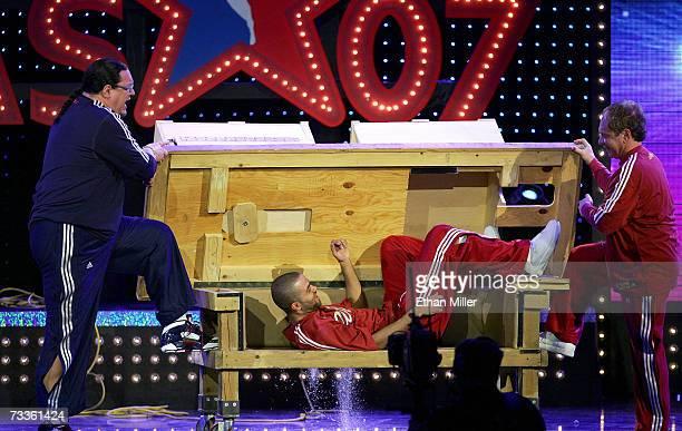 Comedians Penn Jillette and Teller perform a magic trick with NBA's Tony Parker at NBA AllStar Saturday Night at Thomas Mack Center February 17 2007...