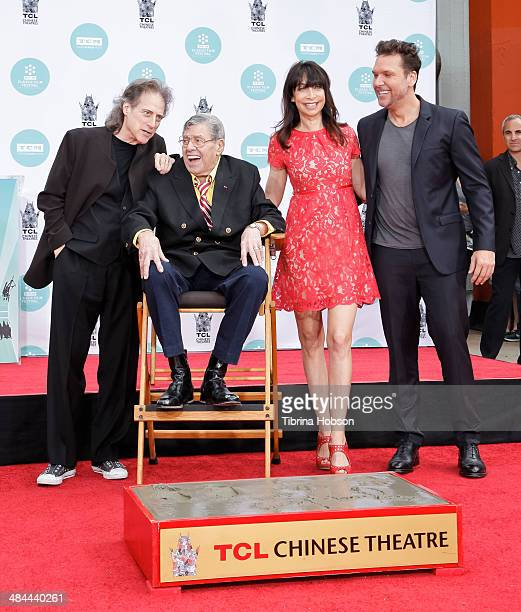 Comedians Richard Lewis Jerry Lewis Illeana Douglas and Dane Cook stand with Jerry Lewis a Lewis is honored with a hand and footprint ceremony at TCL...