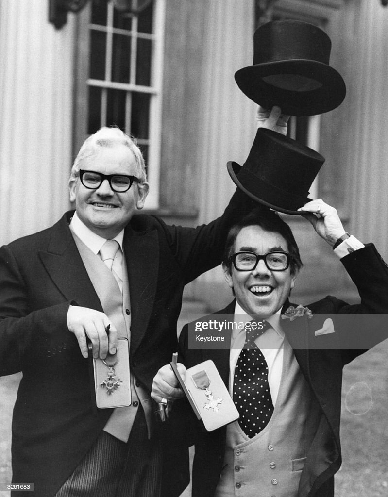 Comedians Ronnie Barker and Ronnie Corbett of double act The Two Ronnies at Buckingham Palace having just collected their OBEs from the Queen 7th...