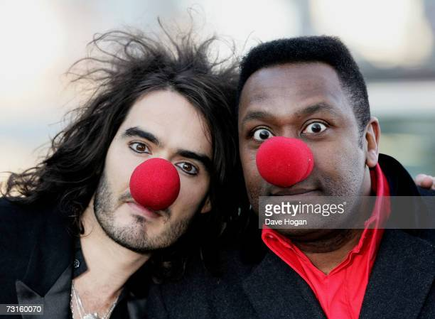 Comedians Russell Brand and Lenny Henry pose at a photocall to launch this year's Comic Relief events at the London Eye on January 31 2007 in London...