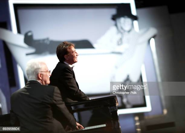 Comedians Steve Martin and Martin Short perform onstage during American Film Institute's 45th Life Achievement Award Gala Tribute to Diane Keaton at...