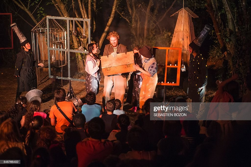 Comedians take part to the Hansel and Gretel opera on July 9, 2016, in ...
